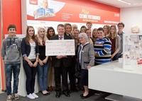 CEWE spendet 1.500 Euro für Hilfsprojekt des Neuen Gymnasiums Oldenburg