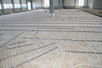 FACHSYMPOSIUM Wirtschaftlichkeit und Nachhaltigkeit: Temperierte Betonböden in Industriehallen