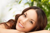 Sommersprossen können durch zu viel UV-Strahlung ausgelöst werden