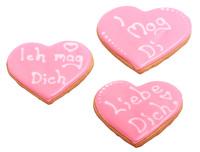 Süße Herzen und Schoko-Pumps zum Valentinstag: Hallingers bietet feinste Pralinen und individuelle Geschenke zum Valentinstag