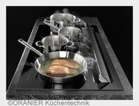 """ORANIER Küchentechnik: """"Glatt"""" gelungen - Flächen-Induktion mit integriertem Kochfeldabzug"""
