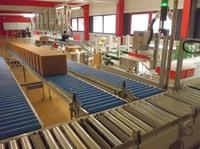 KSL staubtechnik optimiert Abfüll- und Verpackungsprozesse mit AMI Förder- und Lagertechnik