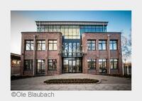 Die neue Adresse für Baustoffe in Hamburg - feierliche Eröffnung der Unternehmenszentrale von Krüger & Scharnberg