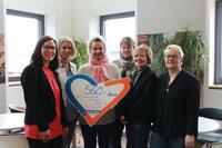 Mitarbeiter der Sparda-Bank München spenden für die Lichtblick Seniorenhilfe