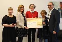 Arvato Financial Solutions spendet 5.000 Euro an Flüchtlingshilfe