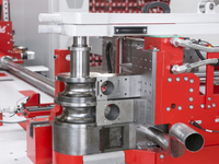 FABTECH: A precise engine manifold with two blade cutting
