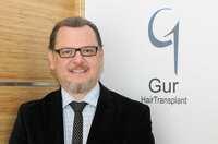 Dr. Gökhan Gür - international anerkannter Chirurg für FUE Haartransplantationen