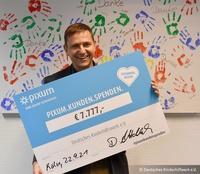 Online-Fotoservice Pixum aus Köln spendet 7.777 Euro an das Deutsche Kinderhilfswerk