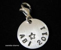Asereba-Charms mit individueller Abi-Prägung: Bleibende Erinnerung an den Schulabschluss 2011